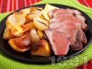 Печено телешко месо с розмарин и картофи на фурна с винен сос